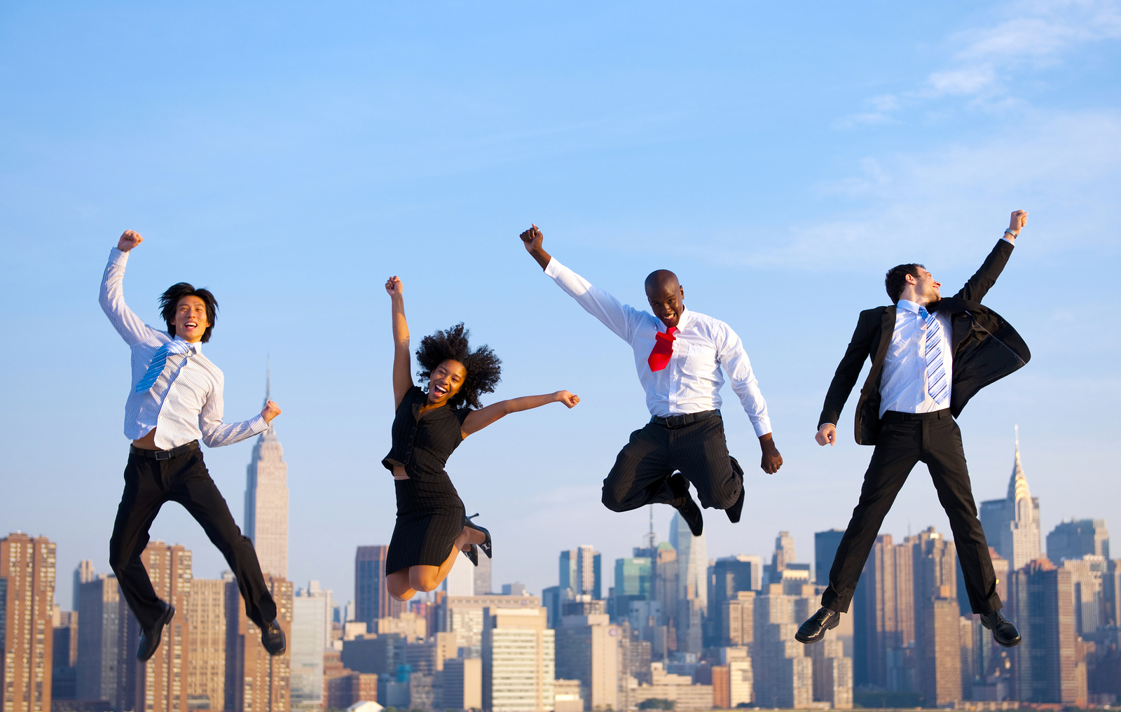 Happy Successful Business People Celebrating and Jumping in New