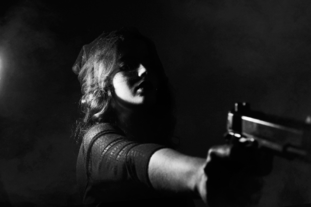 attractive woman holding gun