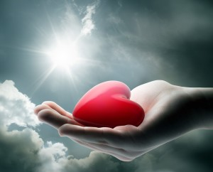 Girl-holding-ligth_on_your_heart_hand_feel_sunshine_save_hd-wallpapers