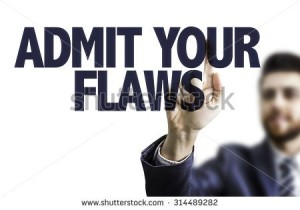 stock-photo-business-man-pointing-the-text-admit-your-flaws-314489282