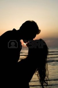 3311483-a-silhouette-of-a-couple-about-to-kiss