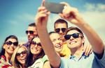 stock-photo-summer-holidays-vacation-and-happiness-concept-group-of-friends-taking-selfie-with-smartphone-192589274