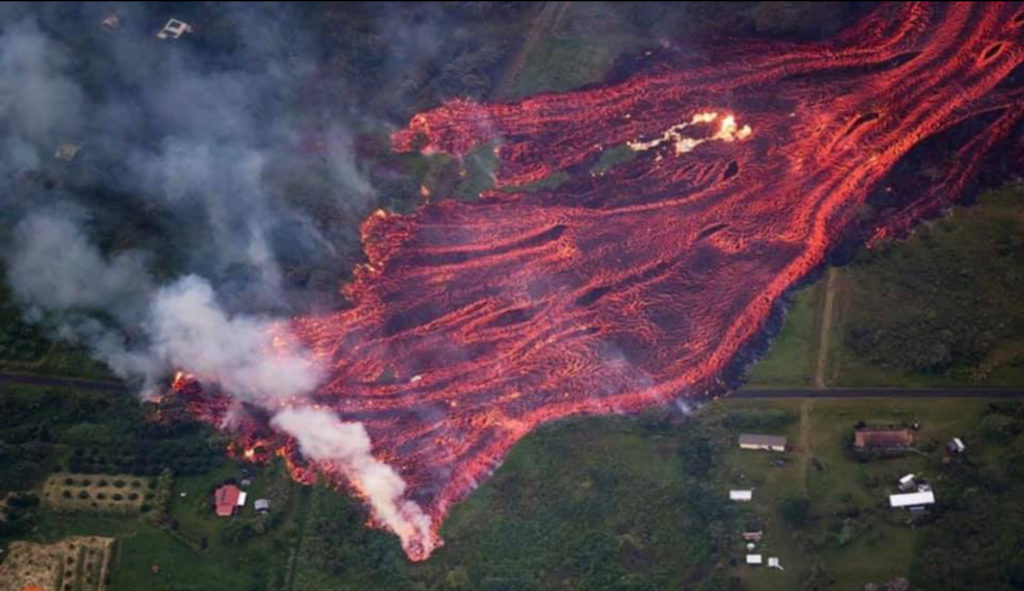 Gigi Ames Hawaii Home - Helicopter view of Lava Sweeping House