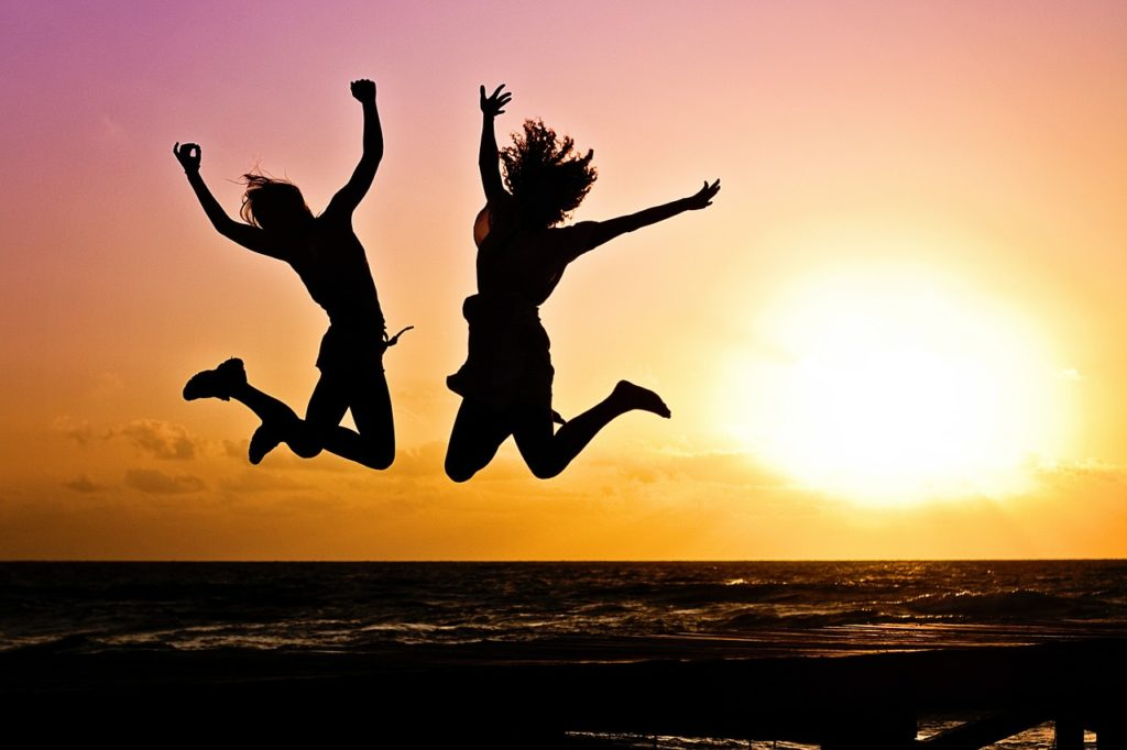 "Long shot of two women jumping in shadow, used for the blog post entitled: ""Quickly Overcome Fear In Network Marketing And Start Actually Having Fun!"""