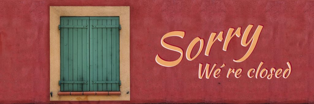 """Long reddish brown sign saying 'Sorry We're Closed' used for the blog post entitled """"What To Do When Your Network Marketing Company Goes Out Of Business!"""""""
