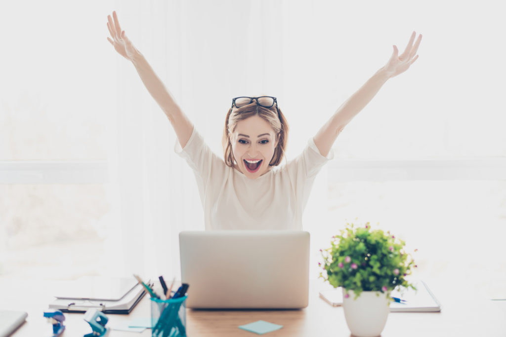 "Excited woman behind her laptop ….used for the blog post entitled: ""Network Marketing Downline: What to do When Nobody's Doing Anything!"""