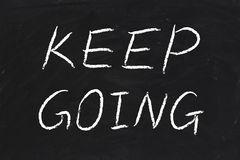 keep-going-text-written-chalk-blackboard-47890847