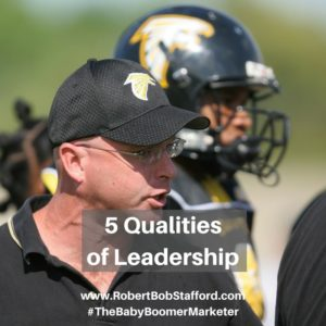 Football coach talking to player showing the 5 Qualities of Leadership