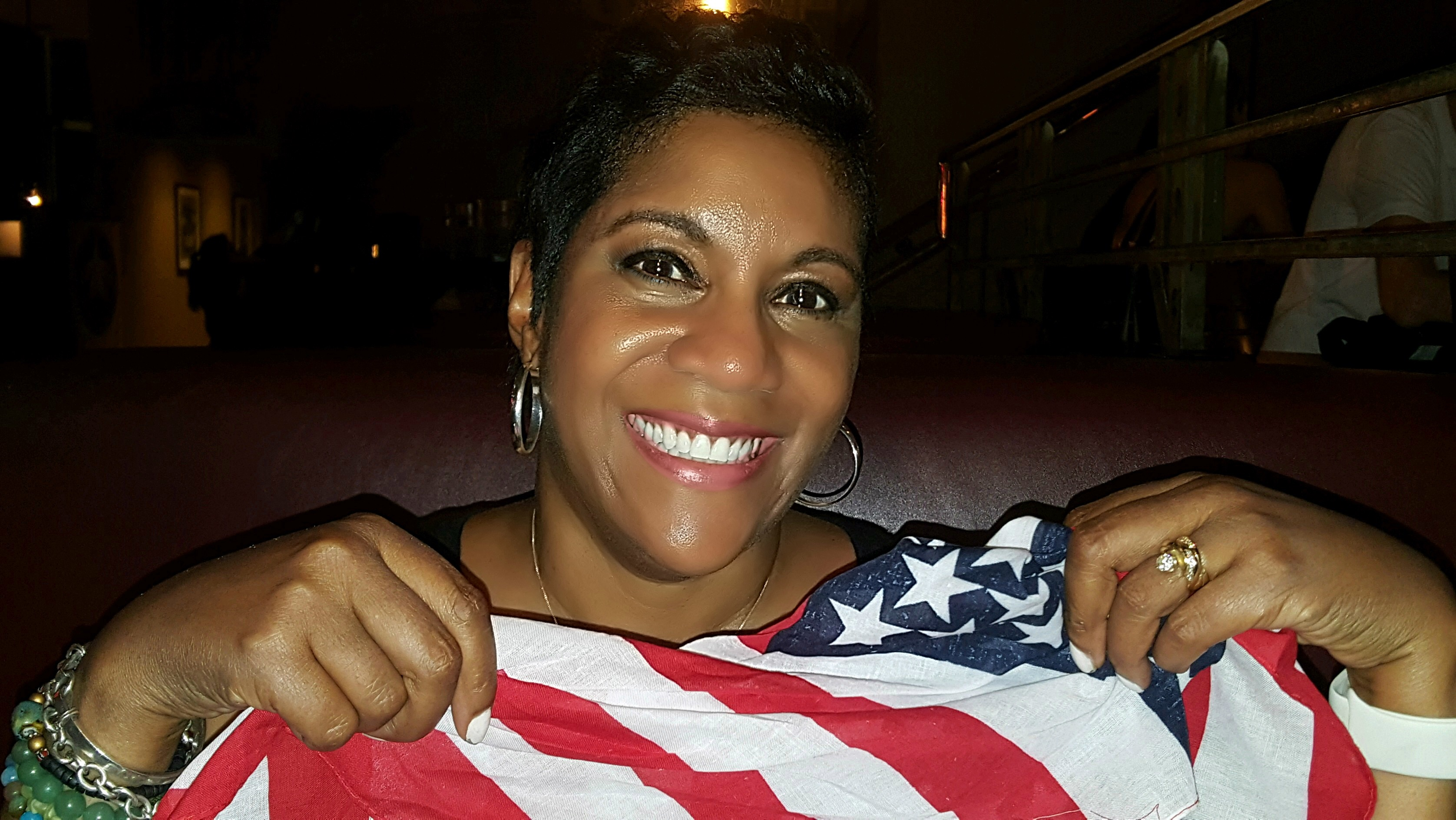 Smiling with the American flag